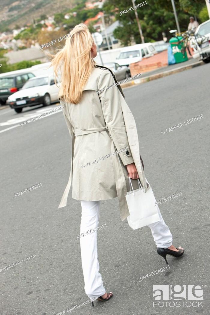 Stock Photo: Woman carrying a shopping bag.