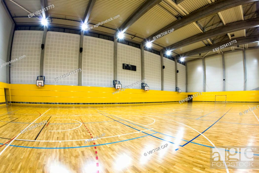 Stock Photo: Interior of a modern multifunctional gymnasium with young people.