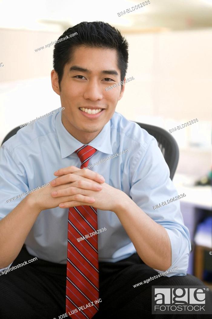 Stock Photo: Korean businessman smiling.