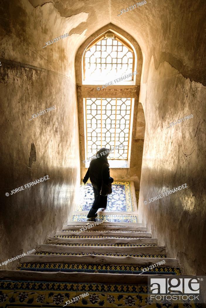 Stock Photo: Iranian woman walking down the stairs, Isfahan, Iran.