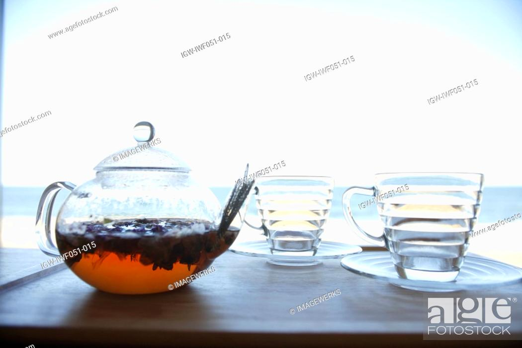 Stock Photo: Teapot and tea cup on table, close-up.