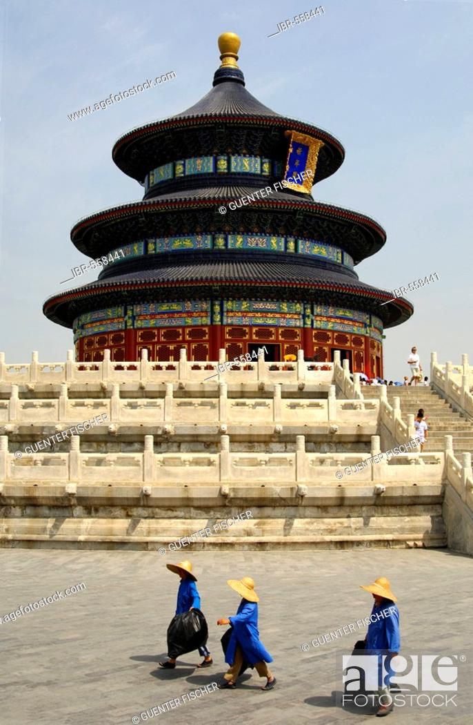 Stock Photo: Three female sanitation workers walking past the Hall of Prayer for Good Harvest, Temple of Heaven, Beijing, China.