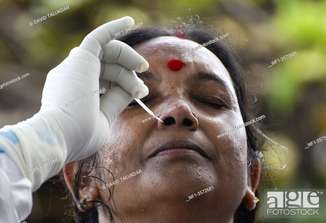 Stock Photo: Health worker collecting swab to rapid test for COVID-19 at Kali Mandir, in Pandu area of Guwahati in Assam, India on 8 July 2020.