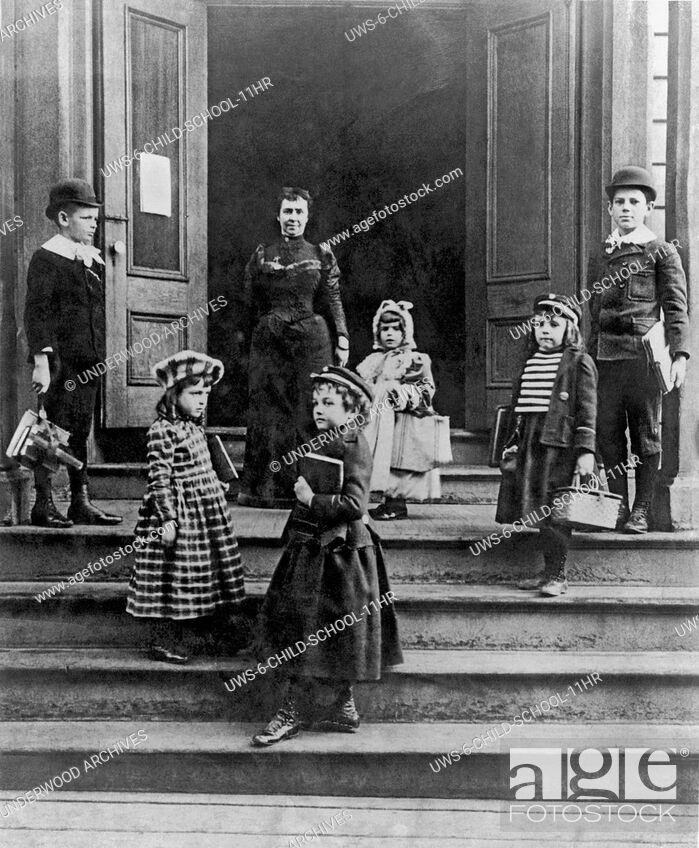 Stock Photo: United States: c. 1880.Children arriving at school with their books straps and wicker lunch baskets.