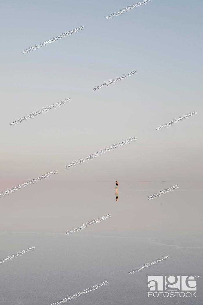 Stock Photo: Distant view of woman standing at Lake Karum, Danakil Depression, Ethiopia, Afar.