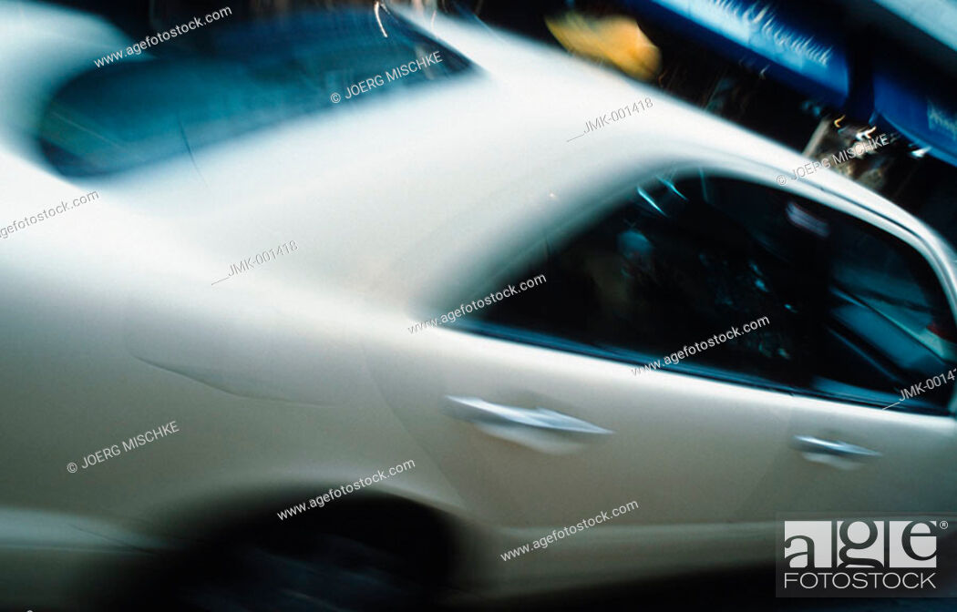 Stock Photo: A car, cab in motion.