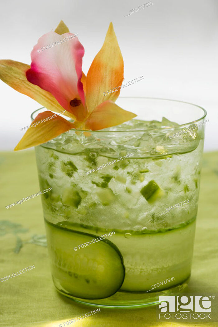 Stock Photo: Refreshing cucumber drink with flower.
