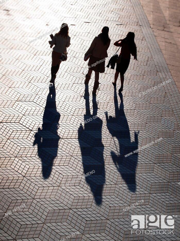 Stock Photo: People walking at sunset.