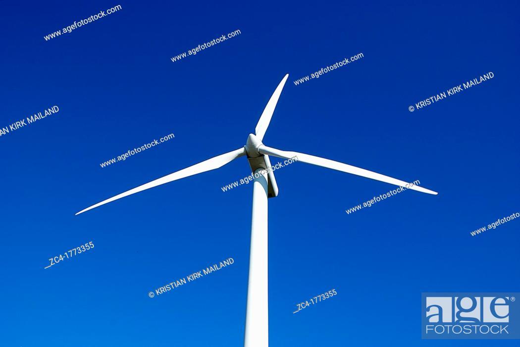 Stock Photo: Scandinavian windturbine against blue sky.