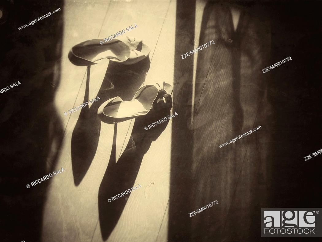 Stock Photo: Woman's High Heel Shoe on a Parquet Floor.