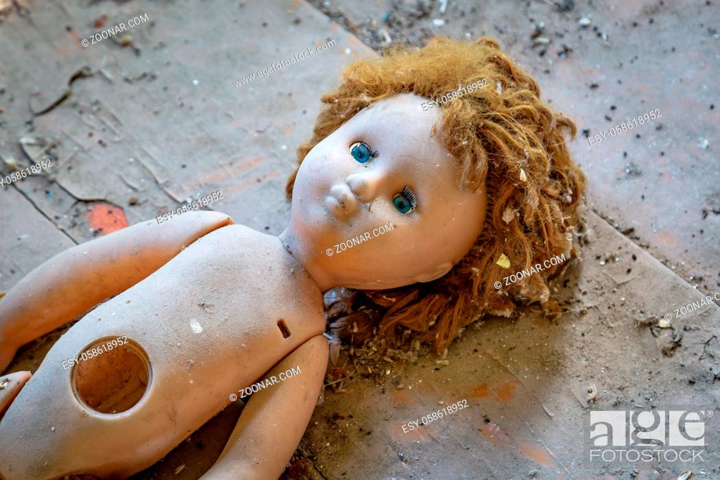 Stock Photo: Abandoned child doll in a abandoned house in Belarus Chernobyl exclusion zone,.