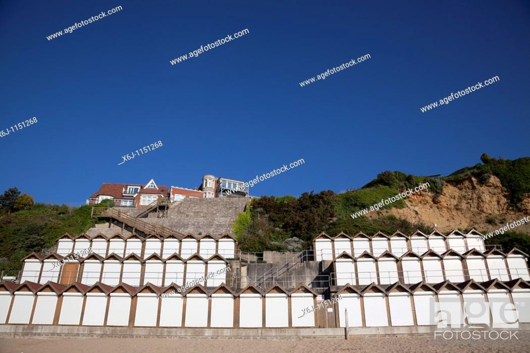 Stock Photo: Beach huts on Swanage beach in early morning sunlight.