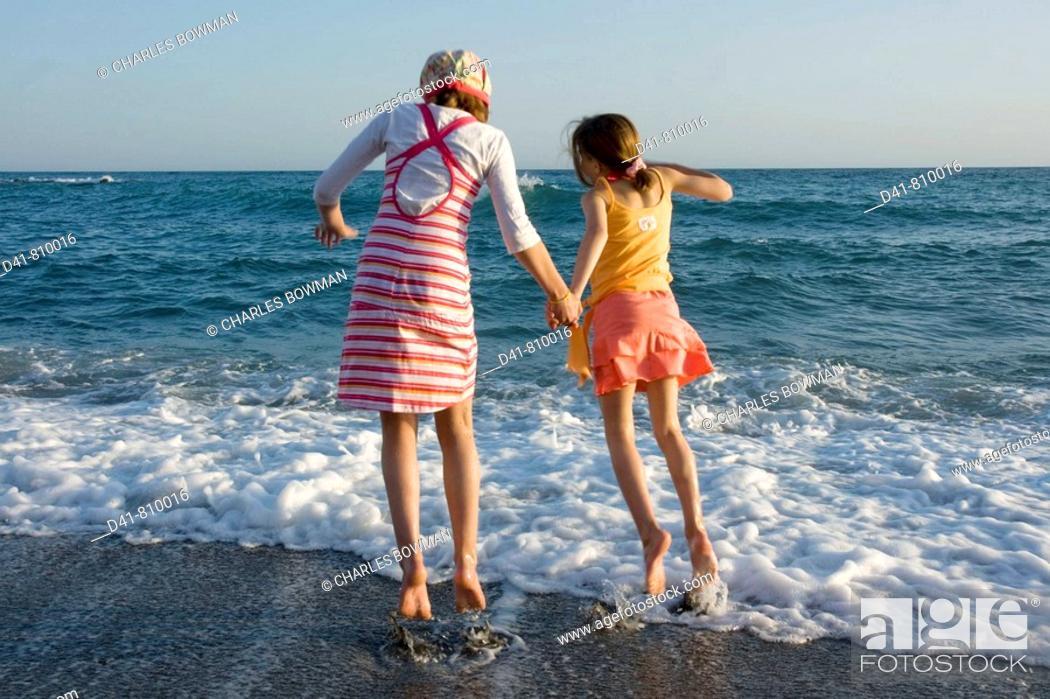 Stock Photo: girl children on beach 2 sisters.