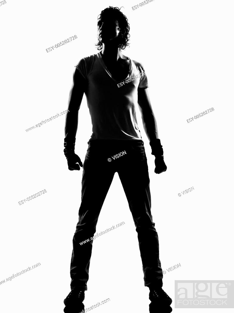 Stock Photo: full length silhouette of a young man dancer dancing standing funky hip hop r&b on isolated studio white background.