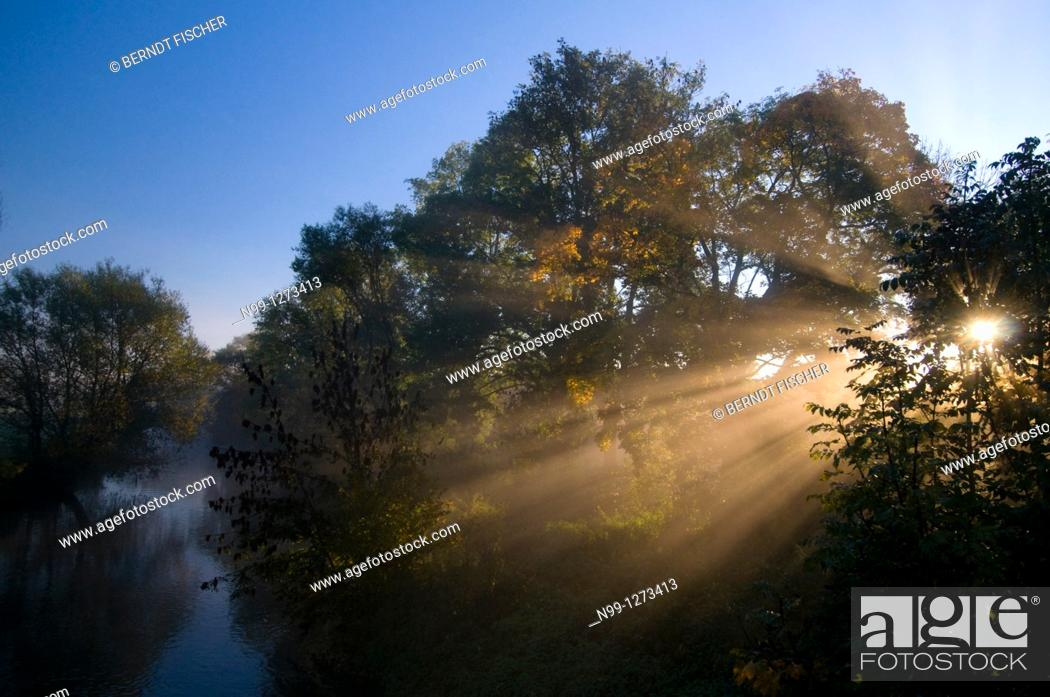 Stock Photo: River valley, Aisch, Sunrise, morning mist, shafts of sunlight, autumn, Bavaria, Germany.