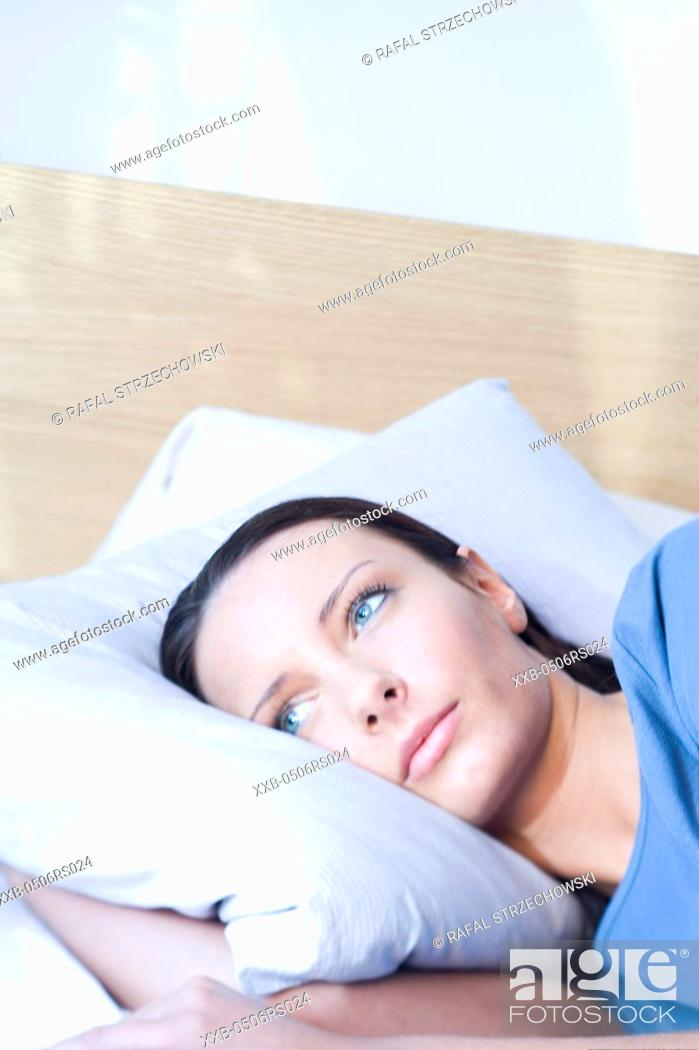 Stock Photo: woman laying in bed.