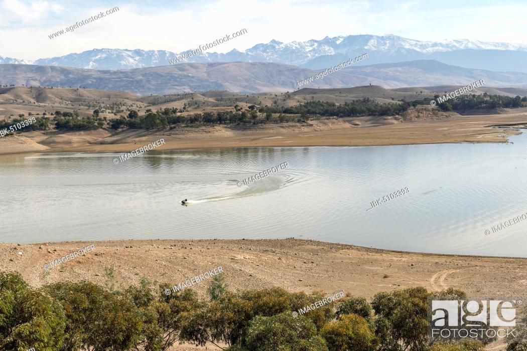 Stock Photo: Motorboat on beautiful Takerkoust Lake and Atlas Mountains south from Marrakech, Morocco, Africa.