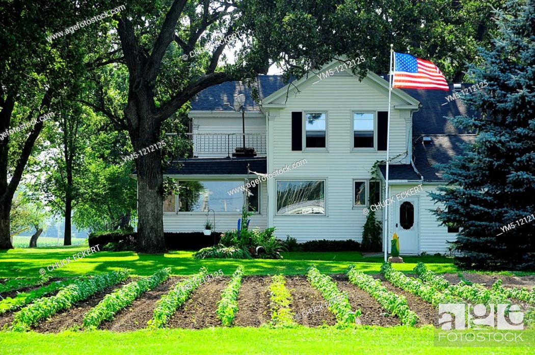 Stock Photo: Wisconsin Farm House, flag & garden.