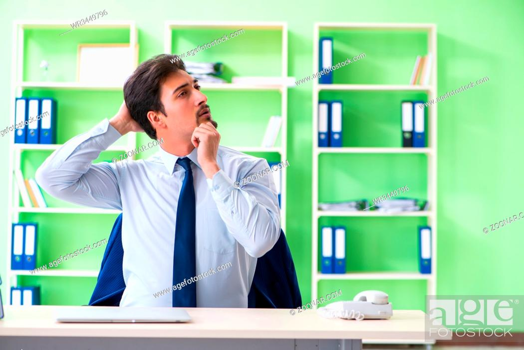 Stock Photo: Employee doing exercises during break at work.