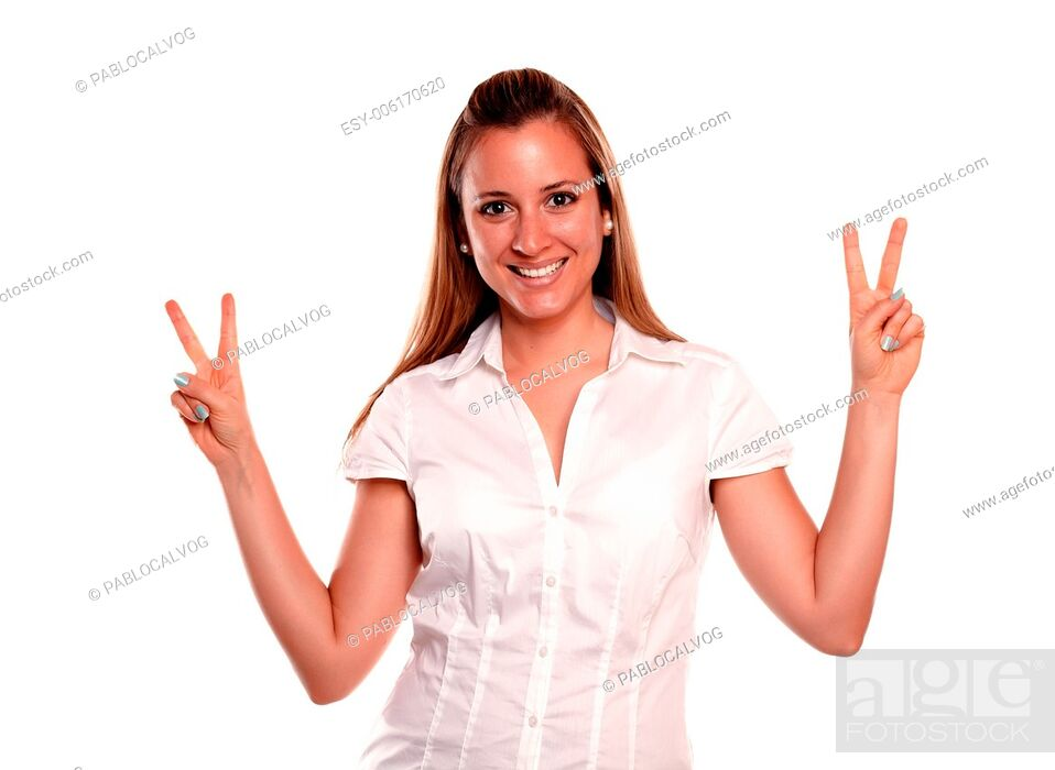 Stock Photo: Friendly young female with a winning attitude looking at you against white background.