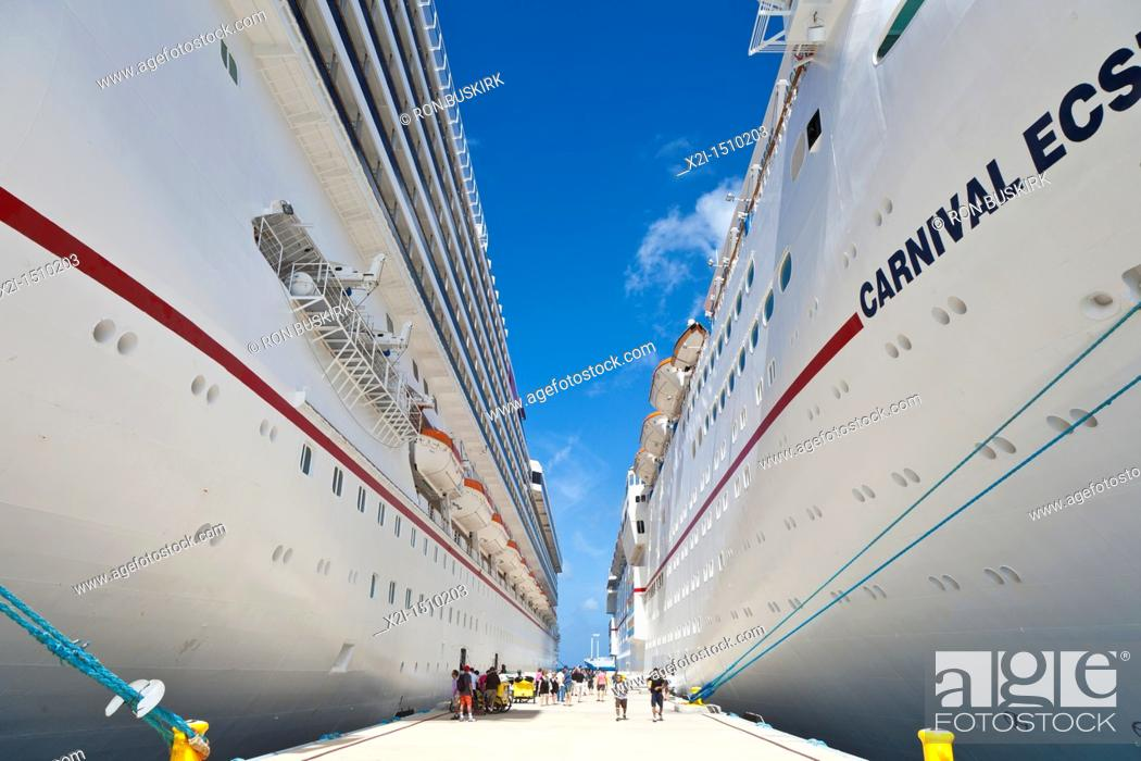 Stock Photo: Cruise ship passengers on pier disembarking from Carnival cruise ships Triumph and Ecstasy in Cozumel, Mexico in the Caribbean Sea.