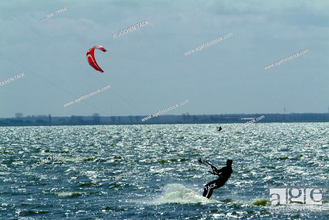 Stock Photo: DEU, Germany, Darss: Kitesurfer in the Saaler Bodden inland sea.
