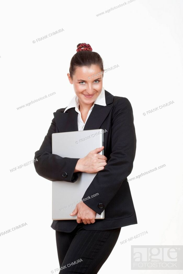 Stock Photo: Smiling businesswoman holding a laptop.
