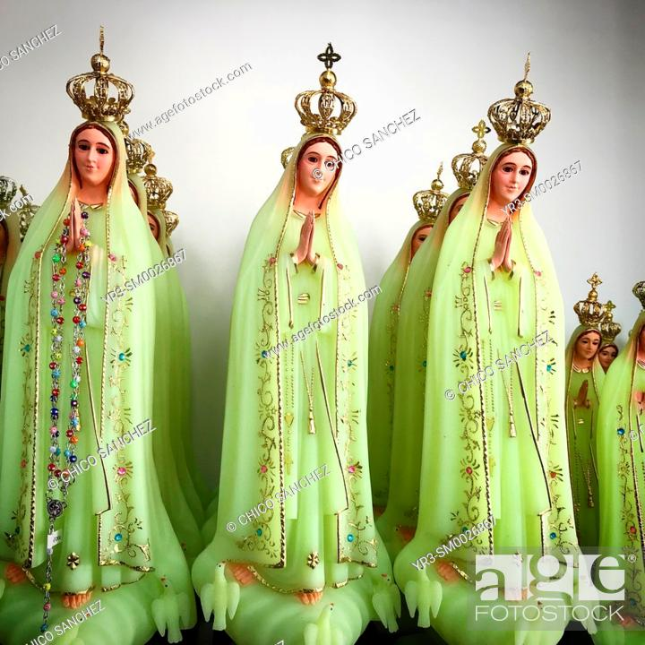 Stock Photo: Green sculptures of Our Lady of the Rosary for sale in a shop in Fatima, Portugal.