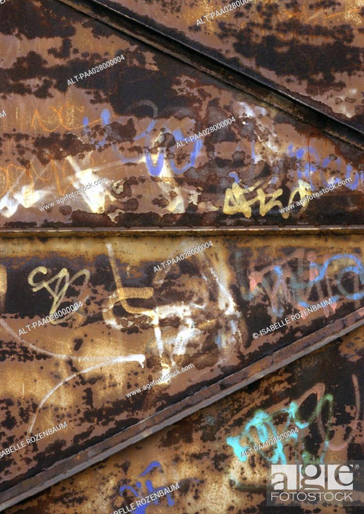 Stock Photo: Graffiti on metal.