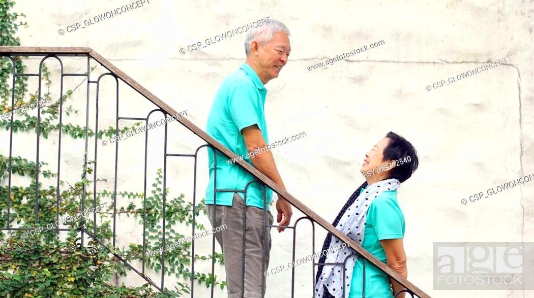 Stock Photo: Asian senior couple travel for anniversary trip.