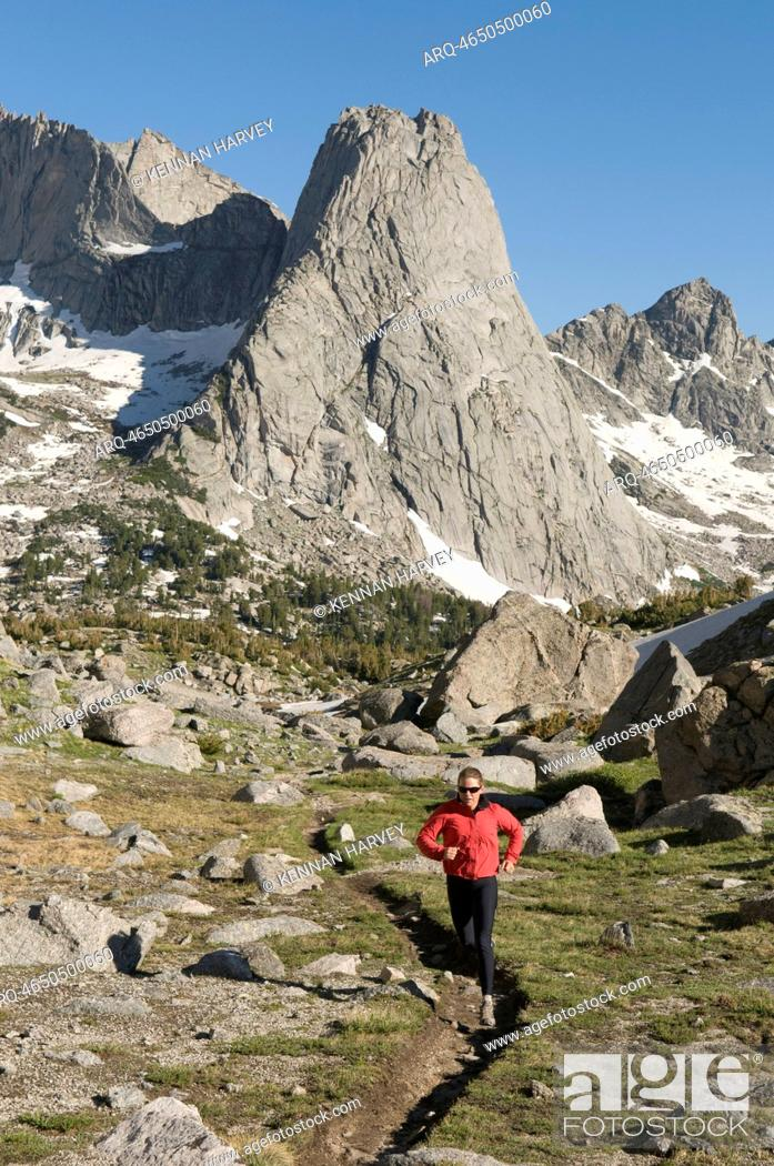 Stock Photo: A woman trail running in the Cirque of Towers, Wind River Range, Pinedale, Wyoming.