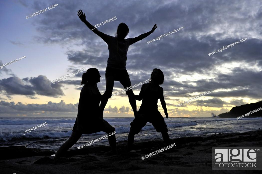 Stock Photo: young women in balance on the beach of Grand Anse Saint-Joseph Reunion island, overseas departement of France, Indian Ocean.