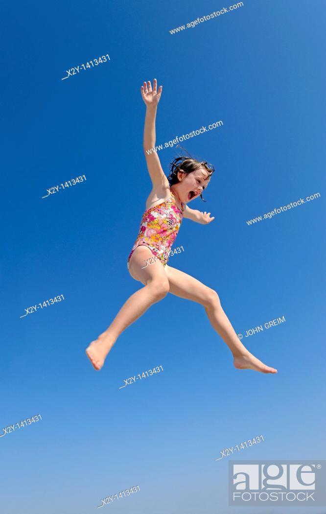 Stock Photo: Jouful girl jumping, Ocean City, New Jersey, USA.