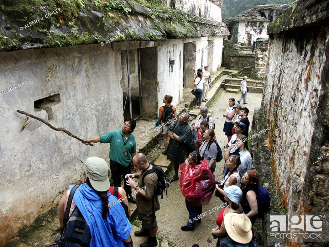 Stock Photo: Guided tourist tour in The Palace of Palenque, Maya archeological site (600 - 800 A.D.). Chiapas, Mexico.