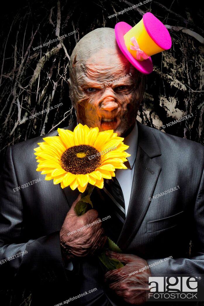Stock Photo: Sad monster in business suit with sunflower.