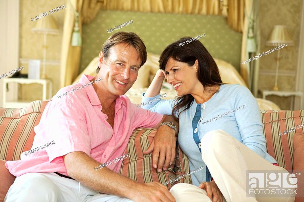 Stock Photo: Happy couple in hotel room.