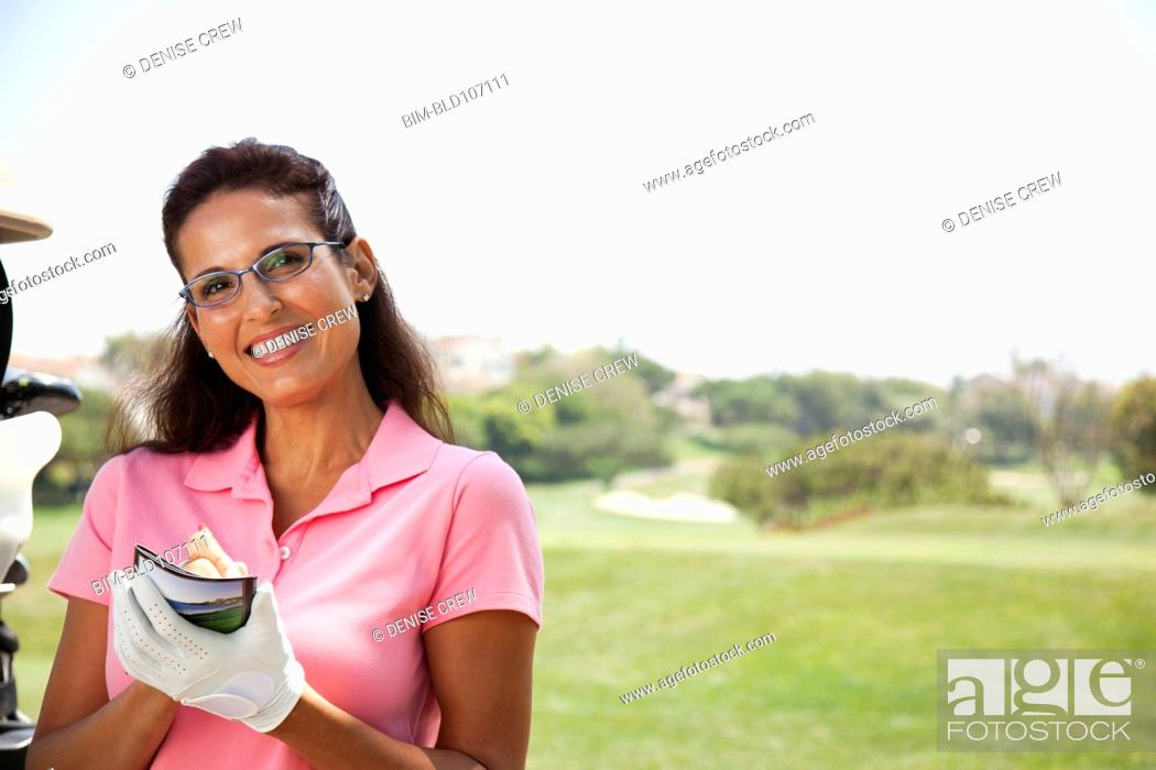 Stock Photo: Woman keeping score during golf game.