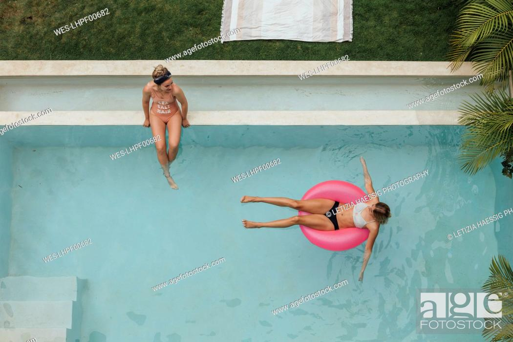 Stock Photo: Two young women relaxing in swimming pool.