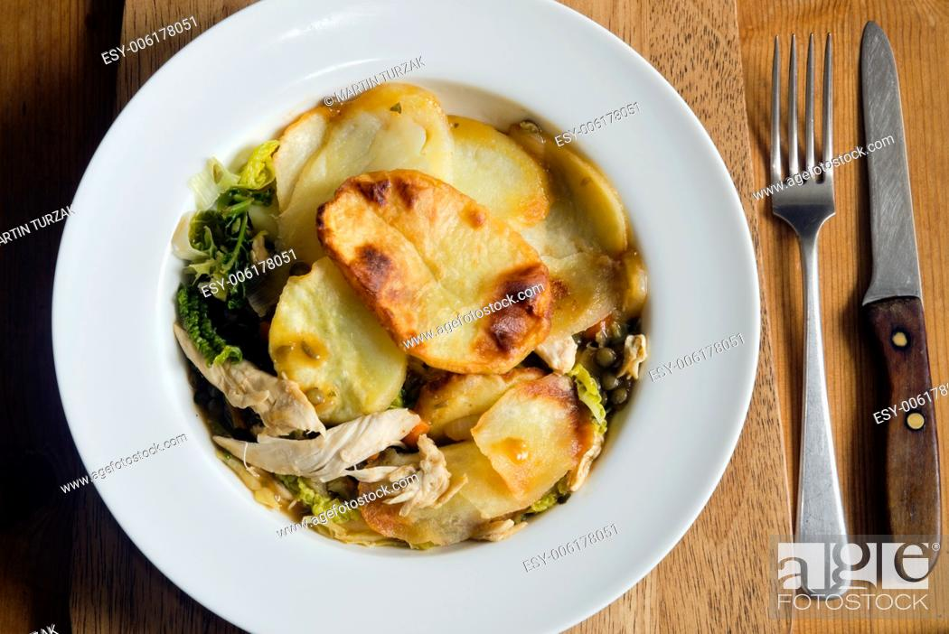 Stock Photo: Chicken and vegetable hotpot with gravy on a plate.