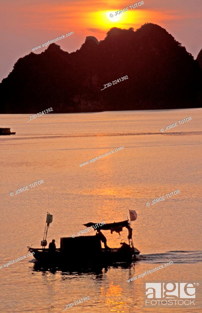 Stock Photo: Boat in the H? Long Bay at sunset UNESCO World Heritage Site Vietnam.