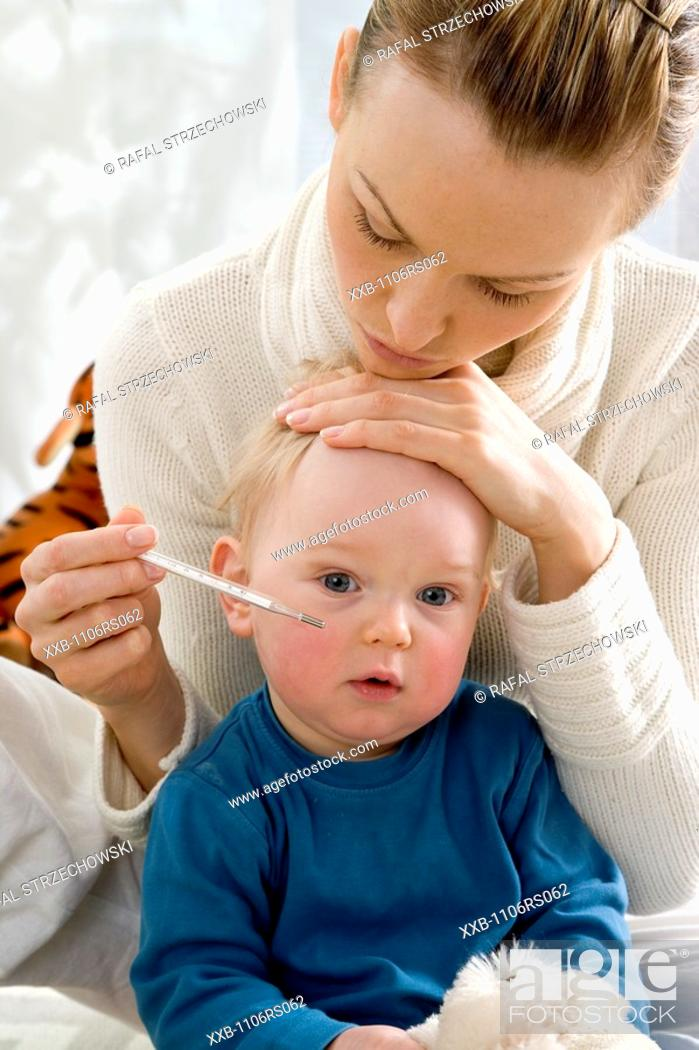 Stock Photo: mum measuring son body tempature.