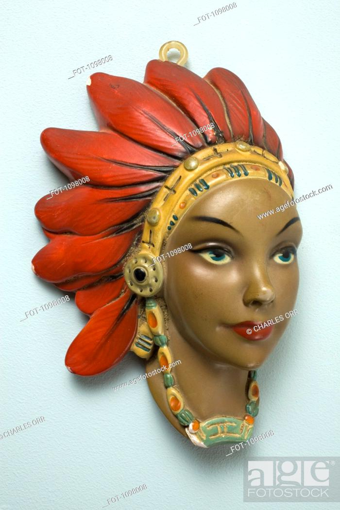 Stock Photo: A retro female mannequin wall hanging, Native American motif.