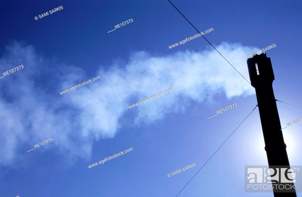 Stock Photo: Smoke billowing from the chimney of a lavender factory.