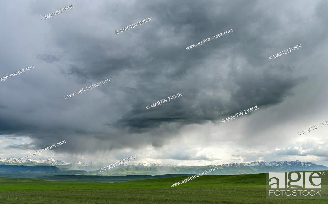 Stock Photo: Thunderstorm over the Suusamyr plain, a high valley in Tien Shan Mountains. Asia, central Asia, Kyrgyzstan.