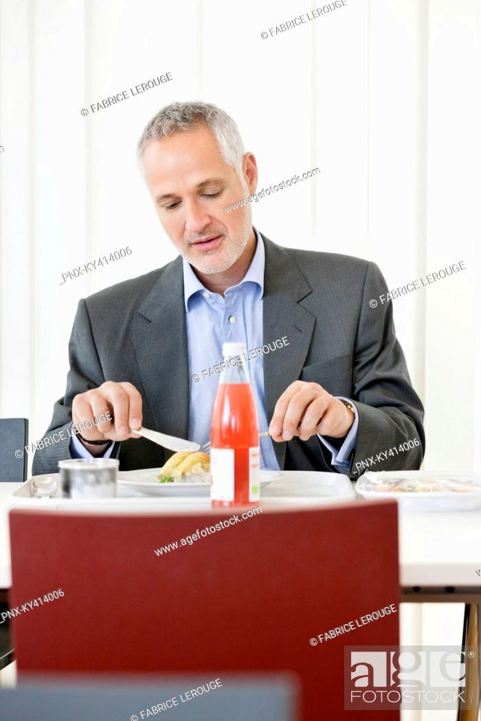 Stock Photo: Businessman having lunch in the office.