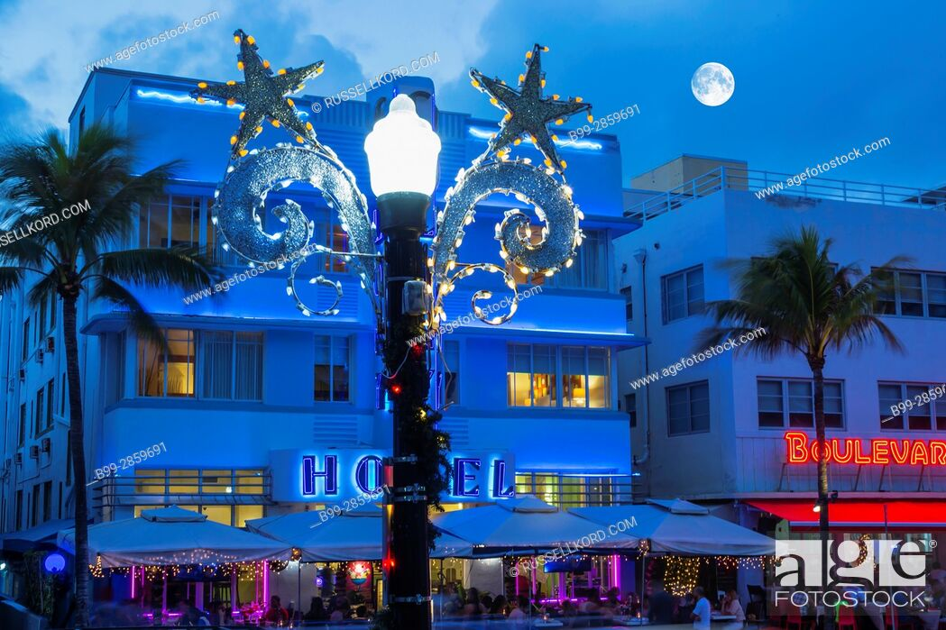 Stock Photo: CHRISTMAS DECORATIONS STREET LAMP HOTELS OCEAN DRIVE SOUTH BEACH MIAMI BEACH FLORIDA USA.