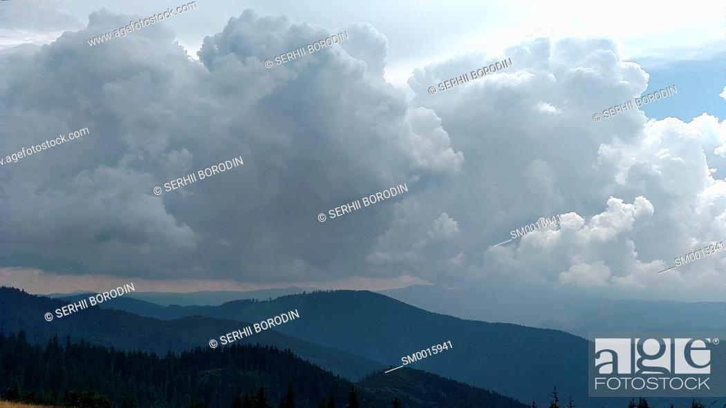 Stock Photo: Mountains and clouds in dark summer day Storm sky in Ukraine Karpathians nature.