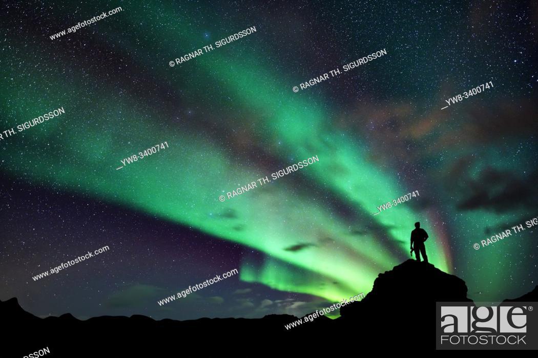 Stock Photo: Photographer and Aurora Borealis, Lake Myvatn, Iceland.