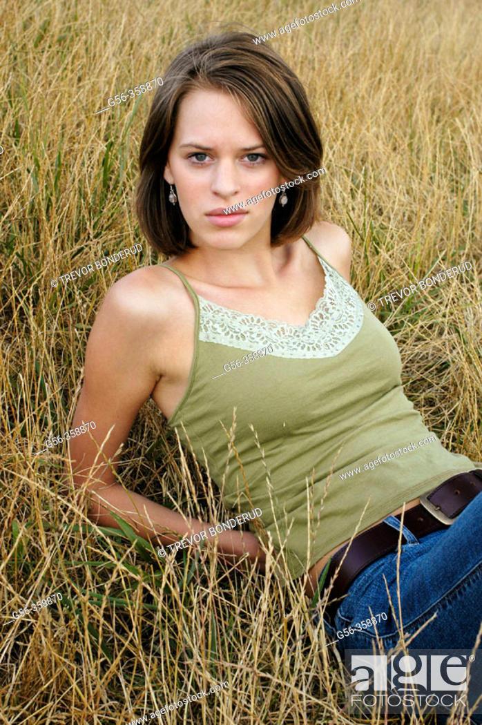Stock Photo: Teen sitting in grass.