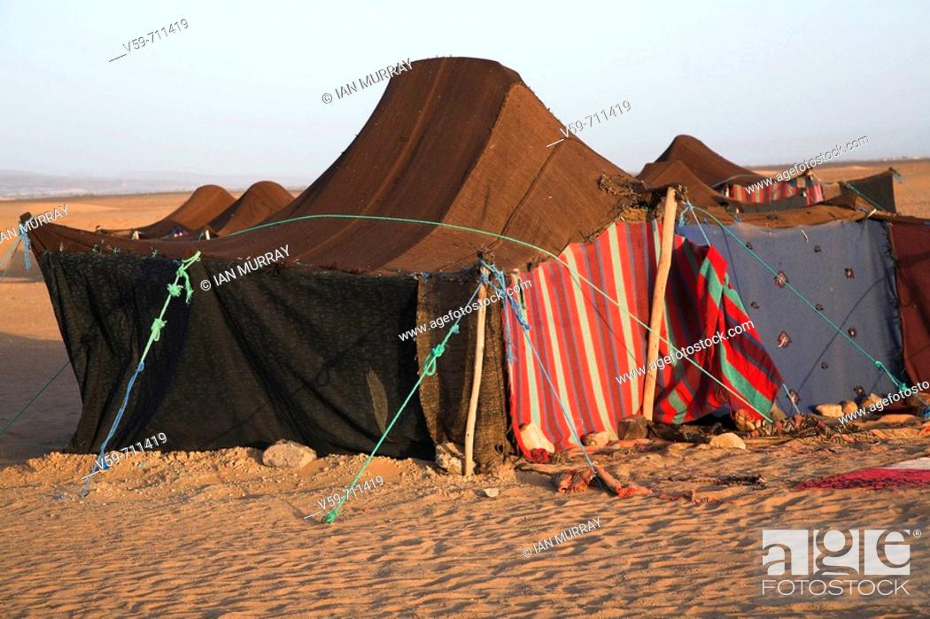 nomadic berber tents used as overnight camp by tourist groups camel